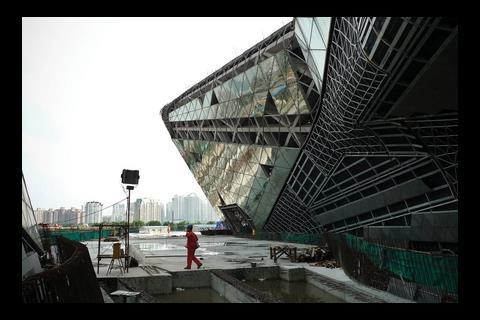 Externally a combination of shiny glass and matt black granite has been used to clad the building.